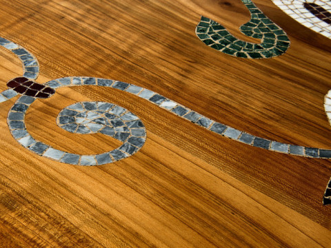 Marble mosaic inlayed in cherry tree wood
