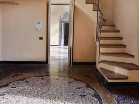 Venice style marble grit floor with mosaic rosette in an Italian Riviera house